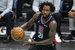 FILE - In this May 13, 2021, file photo, Los Angeles Clippers guard Patrick Beverley (21) brings the ball up court against the Charlotte Hornets during an NBA basketball game in Charlotte, N.C. The Minnesota Timberwolves finalized their acquisition of Beverley, sending 2019 first-round draft pick Jarrett Culver and backup forward Juancho Hernangómez to the Memphis Grizzlies on Wednesday, Aug. 25, 2021. (AP Photo/Jacob Kupferman, File)