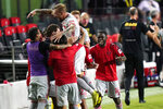 New York Red Bulls' Daniel Royer, center, celebrates after scoring a goal during the second half of an MLS soccer match against Inter Miami, Wednesday, Sept. 23, 2020, in Fort Lauderdale, Fla. (AP Photo/Lynne Sladky)