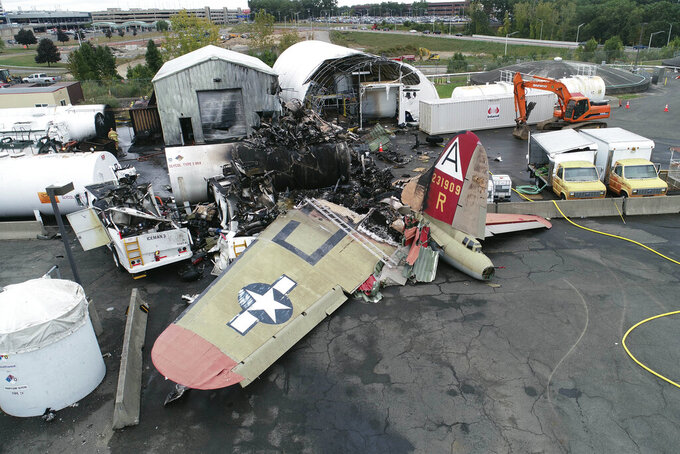 This photo, provided by the National Transportation Safety Board, shows damage from a World War II-era B-17 bomber plane that crashed on Oct. 2, 2019, at Bradley International Airport in Windsor Locks, Conn.  Pilot error was the probable cause of the 2019 crash that killed seven people and wounded six others, the National Transportation Safety Board said in a report released Tuesday, April 13, 2021, that also cited inadequate maintenance as a contributing factor.  (NTSB via AP, File)