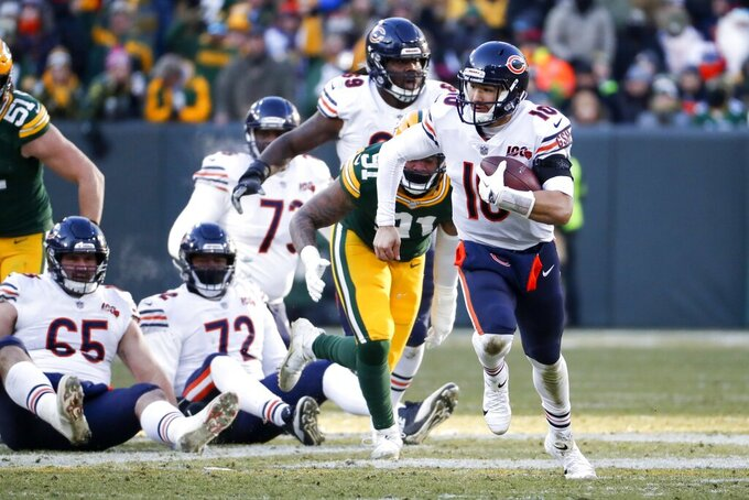 Chicago Bears' Mitchell Trubisky runs during the second half of an NFL football game against the Green Bay Packers Sunday, Dec. 15, 2019, in Green Bay, Wis. (AP Photo/Matt Ludtke)