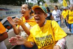 Opposition protester shouts slogans against president Nicolas Maduro and against he failures of public services in the State of Zulia, in Caracas, Venezuela, Thursday, Oct. 24, 2019. Demonstrators mobilized in support of the inhabitants of the western state of Zulia, which suffers daily power outages that sometimes last more than 20 hours. (AP Photo/Ariana Cubillos)