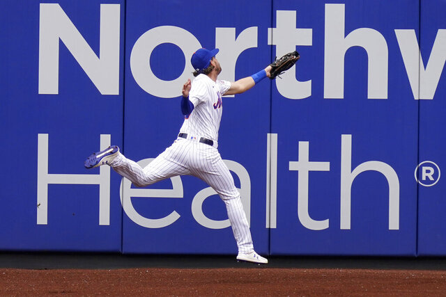 New York Mets left fielder Jeff McNeil injures himself while catching a fly ball during the first inning of a baseball game against the Washington Nationals at Citi Field, Thursday, Aug. 13, 2020, in New York. (AP Photo/Seth Wenig)