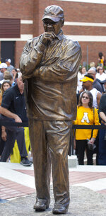 A statue honoring former Appalachian head coach Jerry Moore is revealed during a dedication ceremony outside of Kidd Brewer Stadium in Boone, N.C., on Saturday, Sept. 18, 2021, ahead of an NCAA college football game against Elon. (Kenneth Ferriera/News & Record via AP)