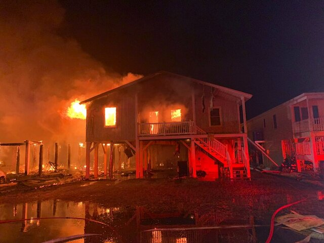 A home is engulfed in flames in Ocean Isle Beach, N.C. Thursday, Aug. 6, 2020. One person has been hospitalized due to the fire that started early Thursday morning.  (Horry County Fire Rescue via AP)