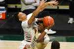 Georgia Tech forward Khalid Moore (12) drives to the basket as Miami guard Isaiah Wong defends during the first half of an NCAA college basketball game, Saturday, Feb. 20, 2021, in Coral Gables, Fla. (AP Photo/Lynne Sladky)