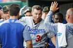 Los Angeles Dodgers' Joc Pederson (31) celebrates in the dugout after hitting a solo home run off Cincinnati Reds starting pitcher Anthony DeSclafani in the third inning of a baseball game, Friday, May 17, 2019, in Cincinnati. (AP Photo/John Minchillo)