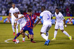 United States' Christian Pulisic (10) dribbles the ball surrounded by Honduras' players during a qualifying soccer match for the FIFA World Cup Qatar 2022 in San Pedro Sula, Honduras, Wednesday, Sept. 8, 2021. (AP Photo/Moises Castillo)
