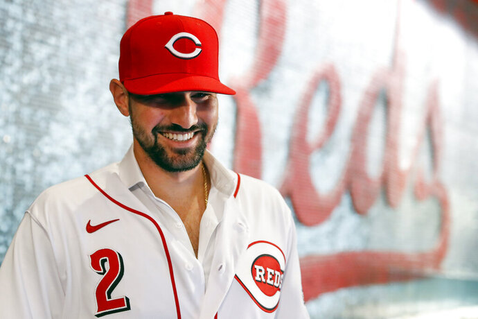 Cincinnati Reds' Nick Castellanos waits for interviews to begin during a news conference announcing his signing with the baseball club, Tuesday, Jan. 28, 2020, in Cincinnati. Castellanos signed a $64 million, four-year deal with the Reds. (AP Photo/John Minchillo)