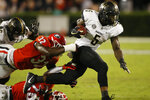Vanderbilt running back Ke'Shawn Vaughn (5) breaks a tackle from Georgia defensive back Tyrique McGhee (26) and linebacker Monty Rice (32) during the first half of an NCAA college football game Saturday, Oct. 6, 2018, in Athens, Ga. (Joshua L. Jones/Athens Banner-Herald via AP)