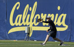 In this March 6, 2019, photo, California's Andrew Vaughn fields a ball during NCAA college baseball practice in Berkeley, Calif. Vaughn began his junior season insistent he had no plans of figuring out a way to top his sensational sophomore season for California. That would be an overwhelming process considering he had among the best years in college baseball.  (AP Photo/Jeff Chiu)