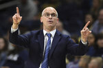 Connecticut head coach Dan Hurley gestures in the first half of an NCAA college basketball game against Iona, Wednesday, Dec. 4, 2019, in Storrs, Conn. (AP Photo/Jessica Hill)