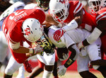South Florida wide receiver Jernard Phillips, bottom, is tackled by Houston linebacker Derek Parish, left, and other defenders during the first half of an NCAA college football game, Saturday, Oct. 27, 2018, in Houston. (AP Photo/Eric Christian Smith)