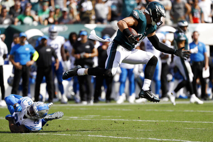 Philadelphia Eagles' Zach Ertz, right, leaps past Detroit Lions' Quandre Diggs during the first half of an NFL football game Sunday, Sept. 22, 2019, in Philadelphia. (AP Photo/Michael Perez)