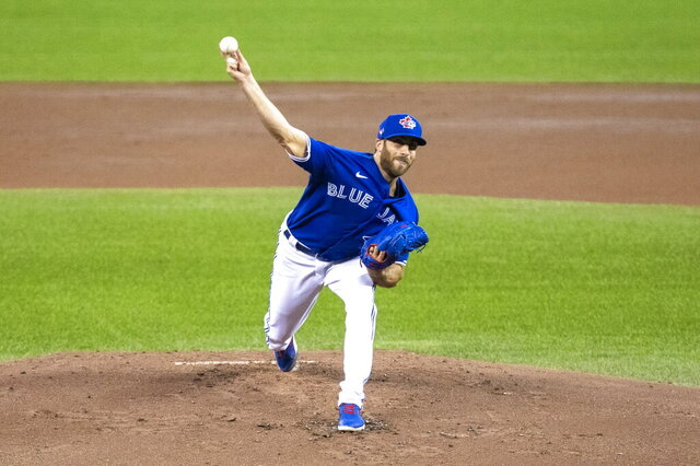 Toronto Blue Jays pitcher Anthony Bass throws during an intrasquad baseball game, Friday, July 10, 2020 in Toronto. (Carlos Osorio/The Canadian Press via AP)