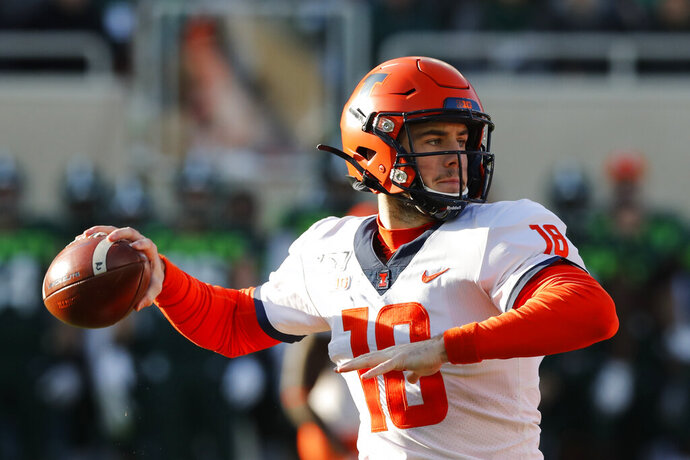 Illinois quarterback Brandon Peters throws during the first half of an NCAA college football game against Michigan State, Saturday, Nov. 9, 2019, in East Lansing, Mich. (AP Photo/Carlos Osorio)
