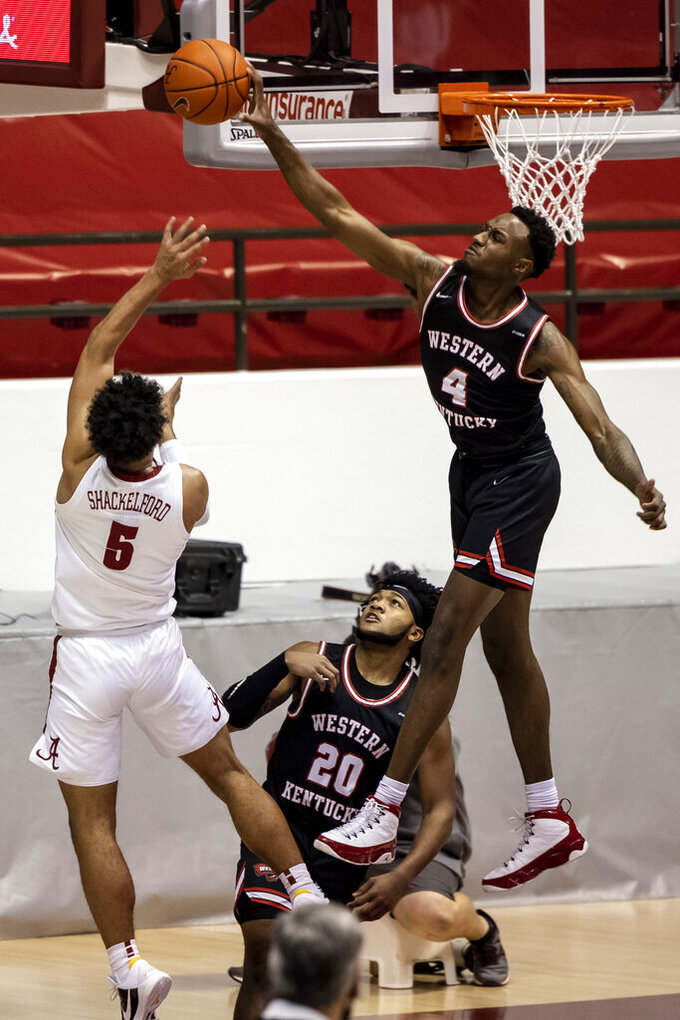 Western Kentucky guard Josh Anderson (4) blocks a shot from Alabama guard Jaden Shackelford (5) during the first half of an NCAA college basketball game, Saturday, Dec. 19, 2020, in Tuscaloosa, Ala. (AP Photo/Vasha Hunt)