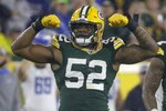 Green Bay Packers' Rashan Gary reacts after forcing a fumble during the second half of an NFL football game against the Detroit Lions Monday, Sept. 20, 2021, in Green Bay, Wis. (AP Photo/Mike Roemer)