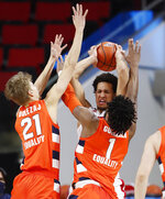North Carolina State's Jericole Hellems (4) is pressured by Syracuse's Marek Dolezaj (21) and Quincy Guerrier (1) during the first half of an NCAA college basketball game, Tuesday, Feb. 9, 2021 in Raleigh, N.C. (Ethan Hyman/The News & Observer via AP, Pool)