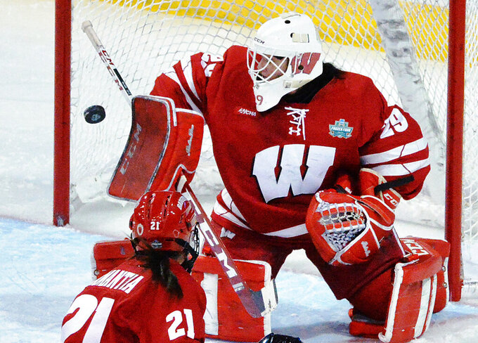 Wisconsin goaltender Kennedy Blair stops a Northeastern shot during the NCAA Women's Frozen Four hockey tournament final Saturday, March 20, 2021, in Erie, Pa. Wisconsin won 2-1 in overtime. (Greg Wohlford/Erie Times-News via AP)