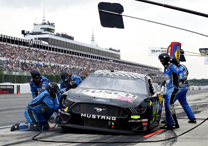 Kevin Harvick makes a pit stop during a NASCAR Cup Series auto race, Sunday, July 28, 2019, in Long Pond, Pa. (AP Photo/Derik Hamilton)
