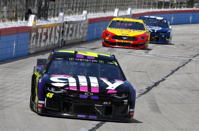 Driver Jimmie Johnson leads the field during a NASCAR Cup auto race at Texas Motor Speedway, Sunday, March 31, 2019, in Fort Worth, Texas. (AP Photo/Larry Papke)