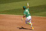 Oakland Athletics' Khris Davis rounds the bases after hitting a solo home run during the fourth inning of Game 2 of an American League wild-card baseball series against the Chicago White Sox, Wednesday, Sept. 30, 2020, in Oakland, Calif. (AP Photo/Eric Risberg)