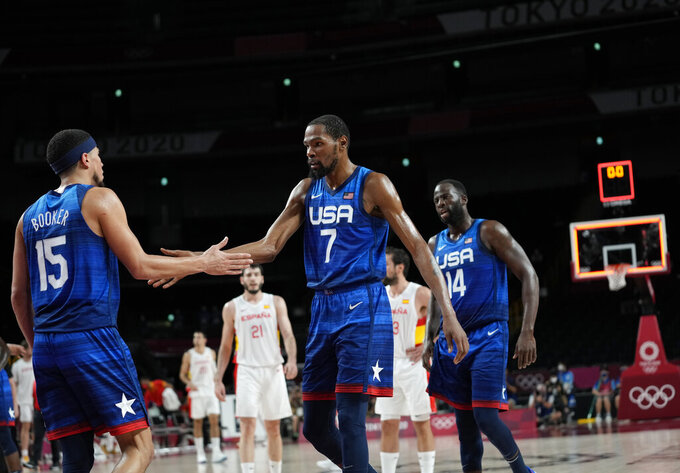 United States' Kevin Durant (7), center, and teammates celebrate their win in the men's basketball quarterfinal game against Spain at the 2020 Summer Olympics, Tuesday, Aug. 3, 2021, in Saitama, Japan. (AP Photo/Eric Gay)