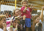 Central American immigrant families look out through the fence of a shelter in Piedras Negras, Mexico, Tuesday, Feb. 5, 2019. A caravan of about 1,600 Central American migrants camped Tuesday in the Mexican border city of Piedras Negras, just west of Eagle Pass, Texas. The governor of the northern state of Coahuila described the migrants as