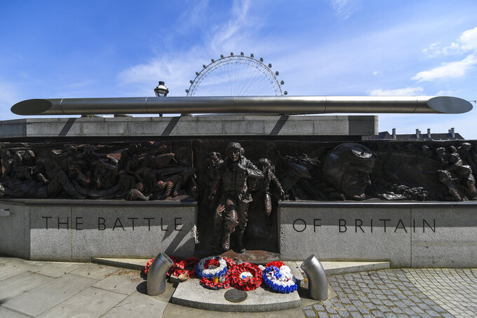 Wreath are left at the memorial of the Battle of Britain in London, Friday, May 8, 2020 on the 75th anniversary of the end of World War II in Europe. The 75th anniversary of the end of World War II in Europe should be all about parades, remembrances, and one last great hurrah for veteran soldiers who are mostly in their nineties. Instead, it is a time of coronavirus lockdown and loneliness spent in search of memories both bitter and sweet.(AP Photo/Alberto Pezzali)