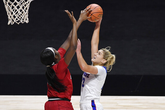 Louisville's Elizabeth Dixon, left, stops a shot-attempt by DePaul's Dee Bekelja in the first half of an NCAA college basketball game, Friday, Dec. 4, 2020, in Uncasville, Conn. (AP Photo/Jessica Hill)