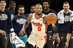 Portland Trail Blazers guard Damian Lillard (0) brings the ball up court during the first half of the team's NBA basketball game against the Memphis Grizzlies on Wednesday, Feb. 12, 2020, in Memphis, Tenn. (AP Photo/Brandon Dill)
