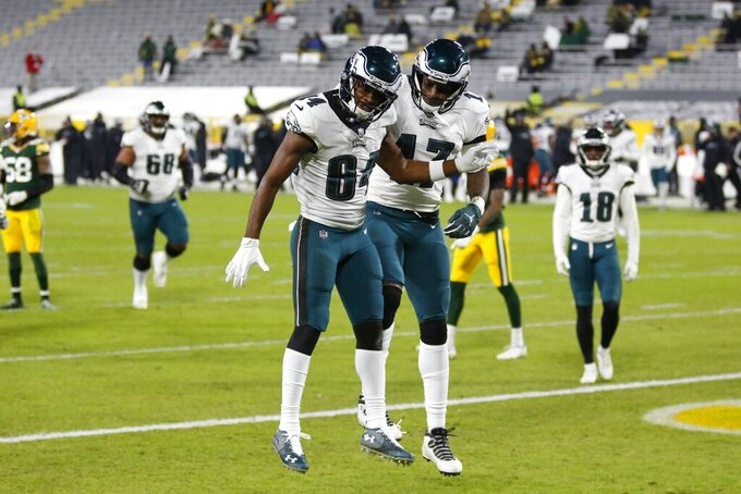 Philadelphia Eagles' Greg Ward (84) celebrates his touchdown catch with Alshon Jeffery (17) during the second half of an NFL football game against the Green Bay Packers Sunday, Dec. 6, 2020, in Green Bay, Wis. (AP Photo/Matt Ludtke)