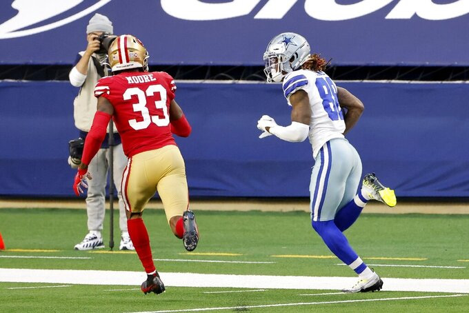 San Francisco 49ers safety Tarvarius Moore (33) gives chase as Dallas Cowboys wide receiver CeeDee Lamb (88) gains yardage after catching a long pass in the second half of an NFL football game in Arlington, Texas, Sunday, Dec. 20, 2020. (AP Photo/Michael Ainsworth)
