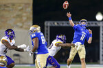Tulsa quarterback Zach Smith (11) throws a pass while being pressured by East Carolina linebacker Bruce Bivens (38) during an NCAA college football game Friday, Oct. 30, 2020, in Tulsa, Okla. (Ian Maule/Tulsa World via AP)