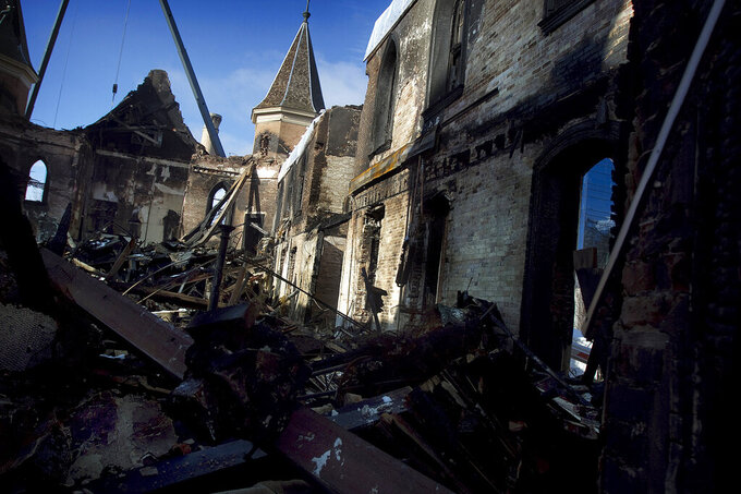 Debris fills the inside of the burned remains of the Provo Tabernacle, Tuesday, Dec. 28, 2010, in Provo, Utah. For many, it seems unbelievable that 10 years have passed since the early morning hours of Dec. 17, 2010, when the historic Provo Tabernacle, decked out for Christmas, housed a raging fire that burned for hours. In what officials described at the time as likely a complete loss, the historic building was gutted by the blaze. (Mark Johnston/The Daily Herald via AP)