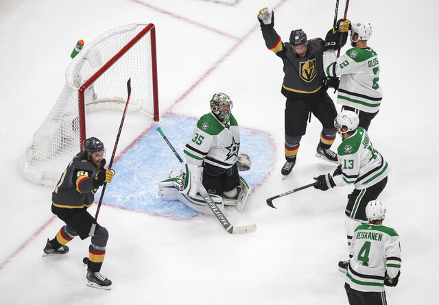 Vegas Golden Knights' Mark Stone (61) and Paul Stastny (26) celebrate a goal against Dallas Stars goalie Anton Khudobin (35) during the second period of Game 2 of the NHL hockey Western Conference final, Tuesday, Sept. 8, 2020, in Edmonton, Alberta. (Jason Franson/The Canadian Press via AP)
