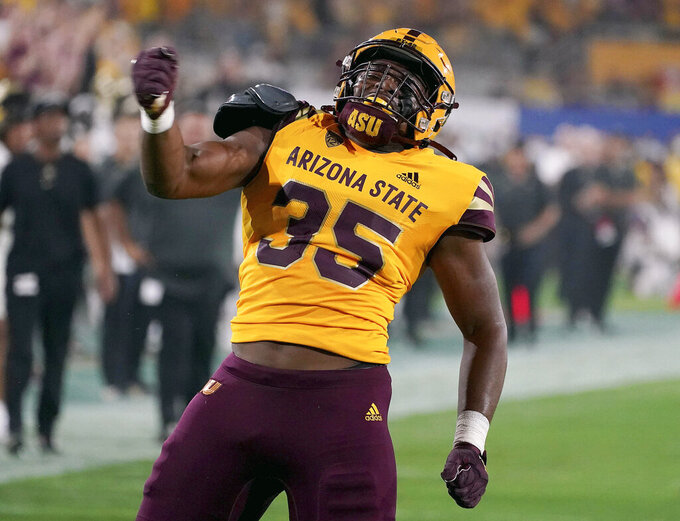 Arizona State defensive lineman B.J. Green (35) pumps his chest after sacking Colorado State quarterback Brendon Lewis (12) for a loss during the first half of an NCAA college football game  Saturday, Sept 25, 2021, in Tempe, Ariz. (AP Photo/Darryl Webb)
