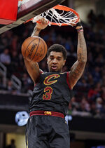 Cleveland Cavaliers' Marquese Chriss dunks against the Charlotte Hornets in the first half of an NBA basketball game, Tuesday, April 9, 2019, in Cleveland. (AP Photo/Tony Dejak)