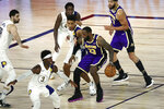 Los Angeles Lakers forward LeBron James (23) is defended by Indiana Pacers guard Malcolm Brogdon (7) during the third quarter of an NBA basketball game Saturday, Aug. 8, 2020, in Lake Buena Vista, Fla. (Kim Klement/Pool Photo via AP)