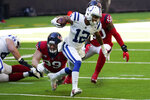 Indianapolis Colts wide receiver De'Michael Harris (12) is pursued by Houston Texans defensive end J.J. Watt (99) during the first half of an NFL football game Sunday, Dec. 6, 2020, in Houston. (AP Photo/David J. Phillip)