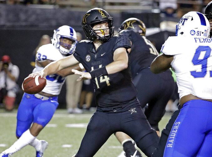 Vanderbilt quarterback Kyle Shurmur (14) passes against Middle Tennessee in the first half of an NCAA college football game Saturday, Sept. 1, 2018, in Nashville, Tenn. (AP Photo/Mark Humphrey)