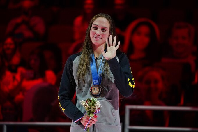 Emma Weyant waves at the award ceremony after winning the Women's 400 Individual Medley at the U.S. Olympic Swim Trials on Sunday, June 13, 2021, in Omaha, Neb. (AP Photo/Charlie Neibergall)