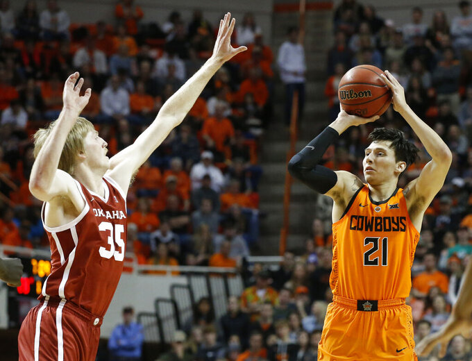 Oklahoma State guard Lindy Waters III (21) shoots as Oklahoma forward Brady Manek (35) defends during the first half of an NCAA college basketball game in Stillwater, Okla., Wednesday, Jan. 23, 2019. (AP Photo/Sue Ogrocki)