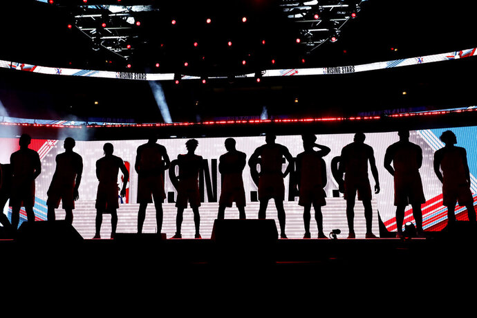 The U.S. Team is introduced at the NBA Rising Stars basketball game in Chicago, Friday, Feb. 14, 2020. (AP Photo/Nam Y. Huh)