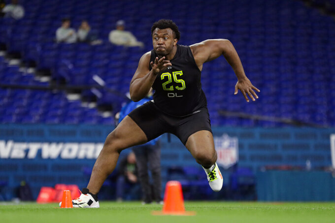 FILE - In this Feb. 28, 2020, file photo, USC offensive lineman Austin Jackson runs a drill at the NFL football scouting combine in Indianapolis. Jackson was chosen by the Miami Dolphins in the NFL draft. (AP Photo/Michael Conroy, File)