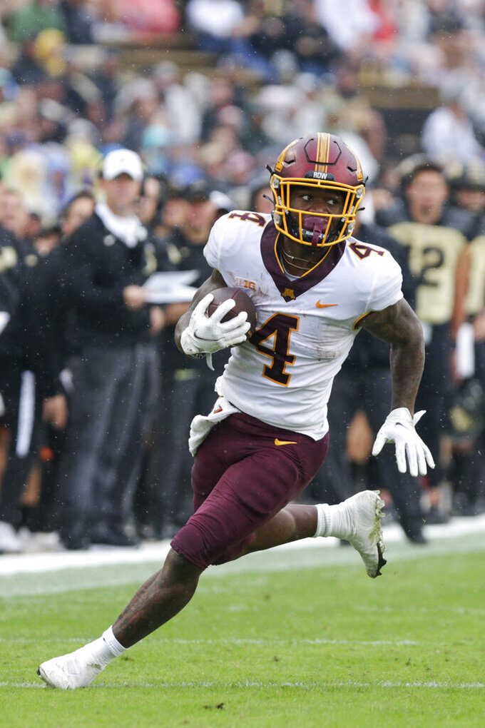 Minnesota running back Mar'Keise Irving (4) runs the ball during the second quarter of an NCAA college football game, Saturday, Oct. 2, 2021, at Ross-Ade Stadium in West Lafayette, Ind. (Nikos Frazier/Journal & Courier via AP)