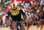 Netherlands' Mike Teunissen crosses the finish line to win the first stage of the Tour de France cycling race over 194.5 kilometers (120,86 miles) with start in Brussels and finish in Brussels. Saturday, July 6, 2019. (AP Photo/Christophe Ena)