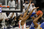 Memphis forward DeAndre Williams (12) attempts a shot against Houston forward Brison Gresham (55) during the first half of an NCAA college basketball game in the semifinal round of the American Athletic Conference tournament Saturday, March 13, 2021, in Fort Worth, Texas. (AP Photo/Ron Jenkins)