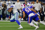 Dallas Cowboys wide receiver Amari Cooper (19) catches a pass for a first down as Buffalo Bills linebacker Matt Milano (58) gives chase in the first half of an NFL football game in Arlington, Texas, Thursday, Nov. 28, 2019. (AP Photo/Michael Ainsworth)