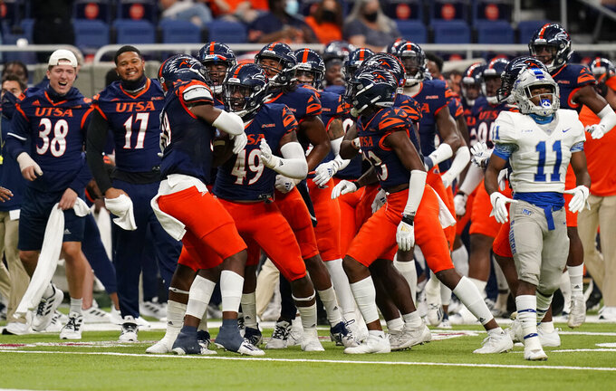 UTSA safety Donyai Taylor (30) celebrates with teammates following an interception during the first half of an NCAA college football game against Middle Tennessee, Friday, Sept. 25, 2020, in San Antonio. (AP Photo/Eric Gay)